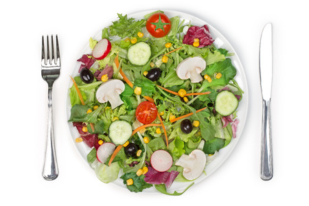 corn meal: top view of a mixed salad plate fork and knife