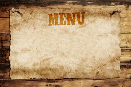 old menu card nailed on a wooden wall Standard-Bild