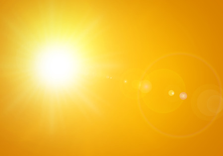 bright sun with lens flare in orange background Stockfoto