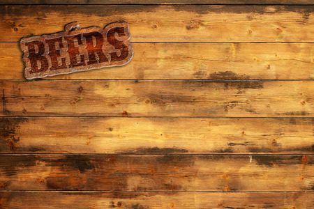 background wood: plaque beers nailed to a wooden board Stock Photo