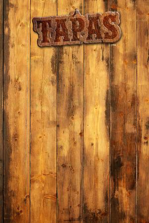 타파스 간판이 나무 벽에 박혀있다. 스톡 콘텐츠