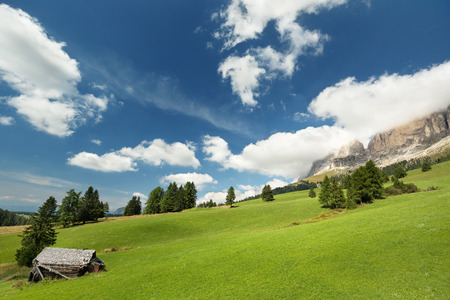 dolomite: hut in alpine meadow and dolomites in the background Stock Photo