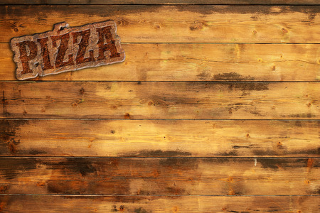 pizza signboard nailed to a wooden wall