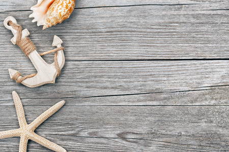 starfish: small anchor and seashells on wooden background Stock Photo