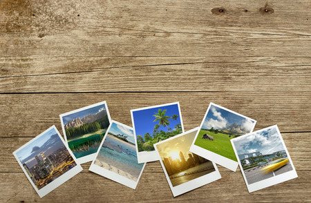 snapshots of travel destinations on wooden background Archivio Fotografico