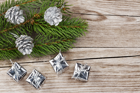 fir cones: fir branch, silver fir cones and gift boxes on wood