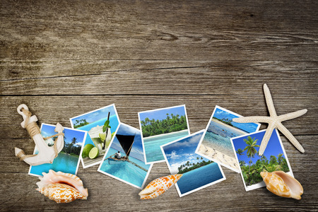 photo of tropical seas and seashells on wooden background Stockfoto
