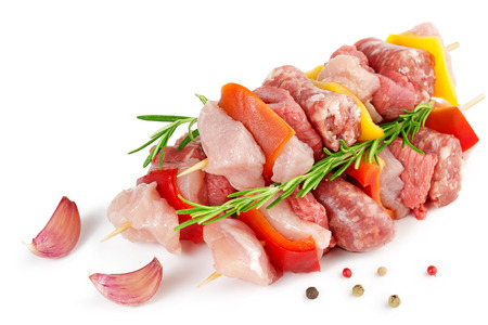 meat skewers: meat skewers, garlic and peppercorns isolated on white Stock Photo