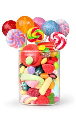 candies: frasco de vidrio lleno de caramelos y piruletas Foto de archivo