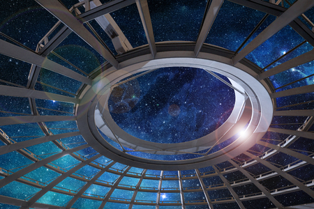 glass dome of astronomical observatory under a starry sky Stock Photo