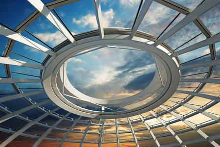未来的なドームの屋根に沈む夕日 写真素材