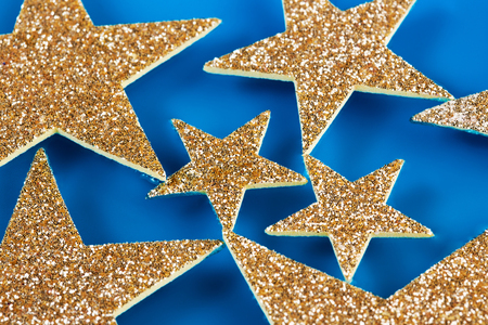 happy holidays: set of glitter stars floating in blue water