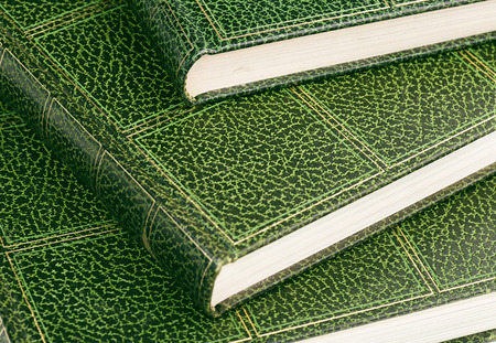 hardcovers: close up of hardcover books with green leather