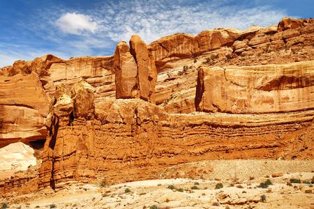 balanced: rock balanced on an orange sandstone cliff