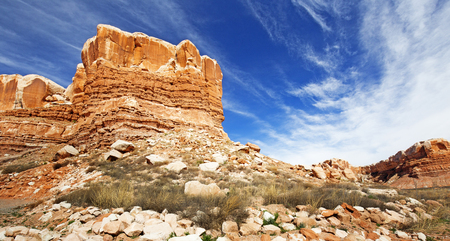 moab: layered sandstone rock formation in a desert landscape Stock Photo