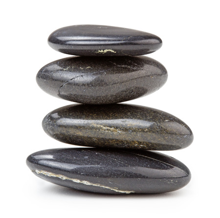 black pebbles stacked, isolated on white background