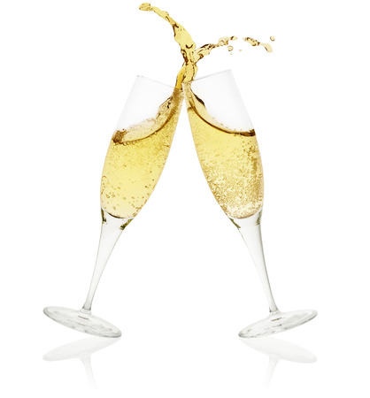 two champagne glasses toasting on white background 스톡 콘텐츠