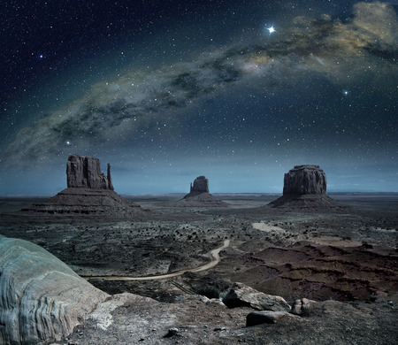 panoramic view of the milky way in monument valley 写真素材