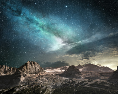 milky way at dawn on a mountain landscape Stock Photo