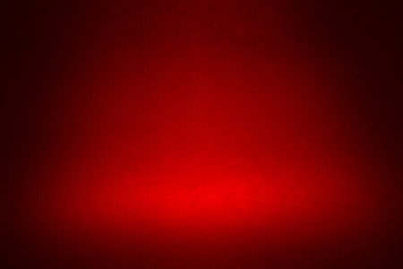paper texture: spotlight on a dark red material abstract background