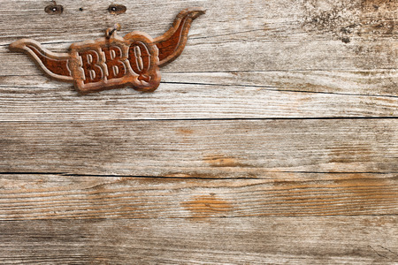 board: bbq sign hung on a wooden wall