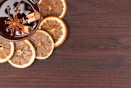 mulled wine and orange slices on wooden background Stock Photo