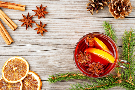cup: mulled wine glass and spices on wooden table Stock Photo