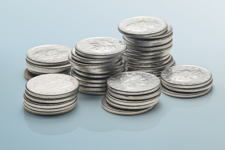 stacks of coins isolated on a reflective surface Stock fotó