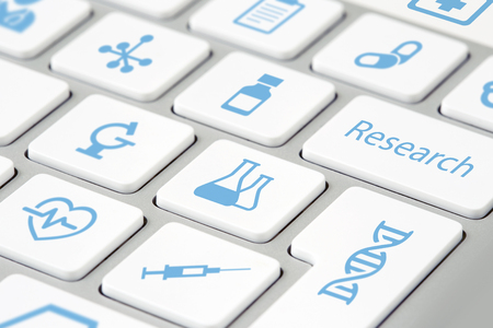 closeup of medical research icons on keyboard buttons
