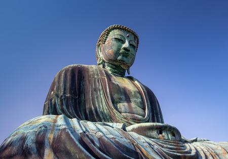 Great Buddha bronze statue under a blue sky, Kamakura Japan