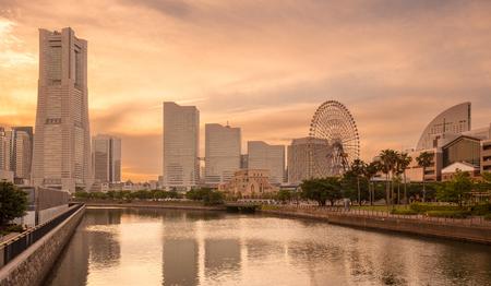 Yokohama modern buildings and river canal at sunset