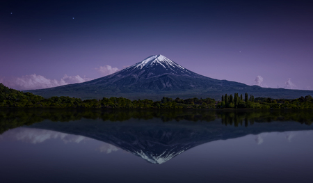 Mount Fuji reflected in the lake with a purple night sky