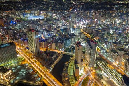 aerial view of buildings and traffic trails at night in Yokohama, Japan Stock fotó