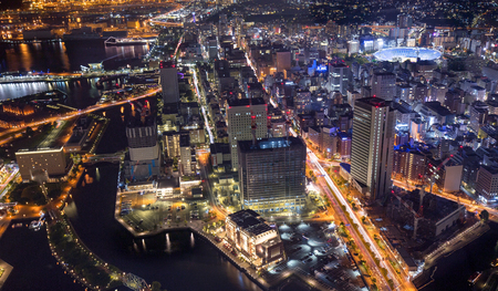 aerial view of waterfront buildings and traffic lights of Yokohama at night
