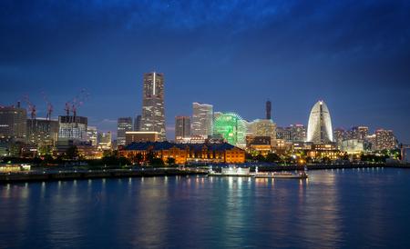 Illuminated buildings on waterfront in Yokohama at night