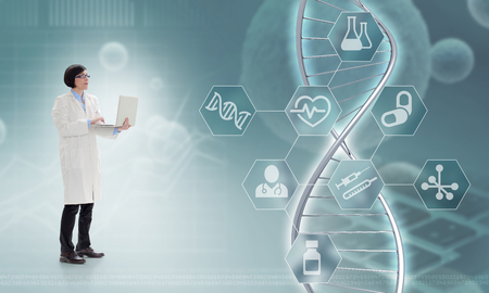 Doctor holding a laptop in front of a DNA hologram, 3d illustration
