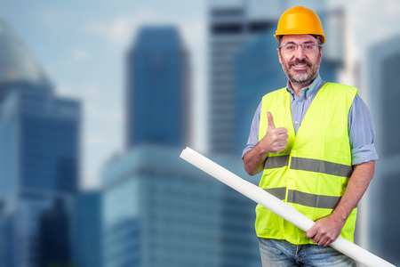 Construction worker, cityscape blurred
