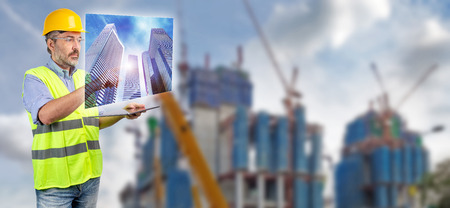 Engineer touching skyscraper hologram