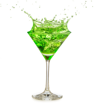Green cocktail splashing in martini glass isolated on white Stock Photo
