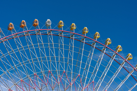 Section of carousel under the blue sky