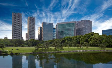 Skyscrapers reflecting in pond water, Hamarikyu park, Tokyo