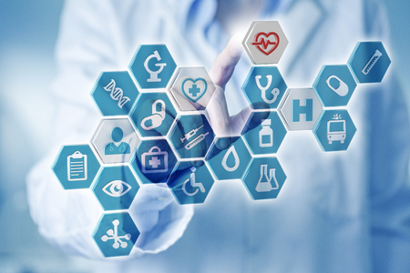Finger touching medical icons on digital screen
