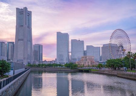Yokohama skyline on river canal at sunset