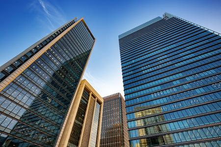 Modern office buildings under a blue sky in Tokyo city