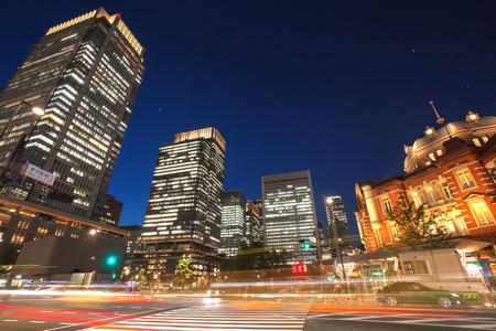 Traffic trails in Marunouchi gate of Tokyo Station