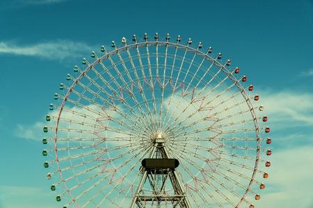 Ferris wheel under the afternoon sky