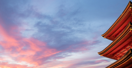Detail of Japanese pagoda in sunset sky Фото со стока