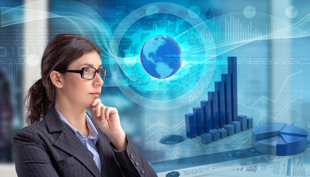 Young businesswoman looking at global financial data charts