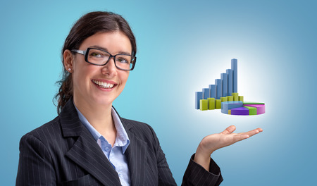 Smiling young businesswoman showing financial growth charts