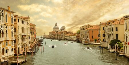 Boats navigating in the Grand Canal with church of Santa Maria della Salute